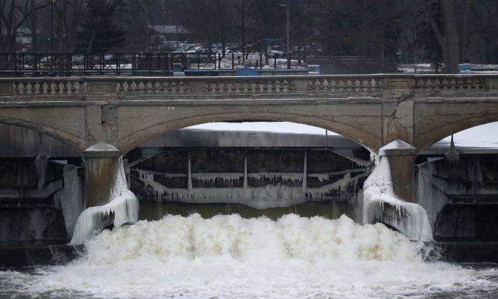 The Flint River is shown near downtown Flint, Mich., Thursday, Jan. 21, 2016. (AP Photo/Paul Sancya)