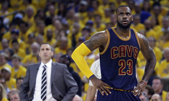 Cleveland Cavaliers forward LeBron James stands on the court near coach David Blatt during Game 2 of basketball's NBA Finals against the Golden State Warriors in Oakland, Calif., on June 7, 2015. James' calculating image wasn't helped when the Cavaliers stunningly fired Blatt on Friday, Jan. 22, despite Blatt leading the team to the NBA Finals last season and an Eastern Conference-best 30-11 record this season. James has played for three coaches during his two stints in Cleveland. (AP Photo/Ben Margot)