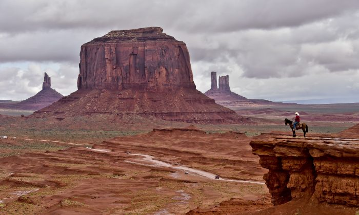 A Navajo man on a horse in front of the Merrick Butte in Monument Valley Navajo Tribal Park, Utah, on May 16, 2015. (Mladen Antonov/AFP/Getty Images)
