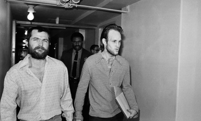 """Charles Manson followers Bruce Davis (L) and Steve Grogan leaving court after a hearing in Los Angeles on Dec. 22, 1970. Gov. Jerry Brown has rejected parole for Davis a follower of cult leader Charles Manson 46 years after a series of bloody murders rocked Southern California, Friday, Jan. 22, 2016. Bruce Davis was convicted of the 1969 slayings of musician Gary Hinman and stuntman Donald """"Shorty"""" Shea. He was not involved in the more notorious killings of actress Sharon Tate and six others. (AP Photo/Harold Filan)"""