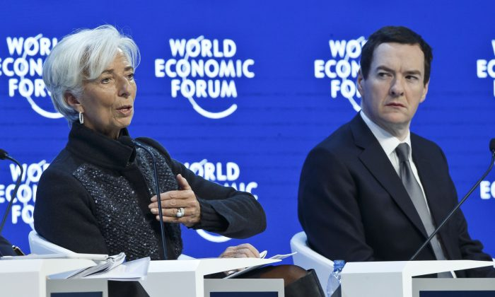 """Managing Director of the International Monetary Fund Christine Lagarde (L) gestures while Britain's Chancellor of the Exchequer George Osborne listens during a panel, """"The Global Economic Outlook,"""" at the World Economic Forum in Davos, Switzerland, on Jan. 23, 2016. World leaders are holding a flurry of diplomatic meetings at the World Economic Forum and worried CEOs are debating about how to deal with this year's volatile markets and low oil prices. (AP Photo/Michel Euler)"""