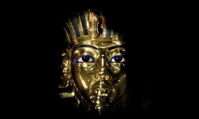 The gold mask of King Tutankhamun is displayed in its glass case, in the Egyptian Museum near Tahrir Square, in Cairo, Wednesday, Dec. 16, 2015. (AP Photo/Nariman El-Mofty)