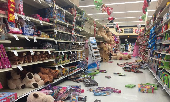 In this photo provided by Vincent Nusunginya, items fallen from the shelves litter the aisles inside a Safeway grocery store following a magnitude 6.8 earthquake on the Kenai Peninsula on Sunday Jan. 24, 2016, in south-central Alaska. (Vincent Nusunginya via the AP)