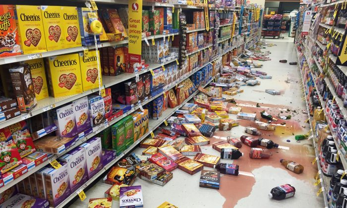 Boxes of cereal and bottles of juice lie on the floor of a Safeway grocery store following a magnitude 6.8 earthquake on the Kenai Peninsula in south-central Alaska on Jan. 24, 2016. The quake knocked items off shelves and walls in south-central Alaska and jolted the nerves of residents in this earthquake prone region, but there were no immediate reports of injuries. (Vincent Nusunginya via the AP)