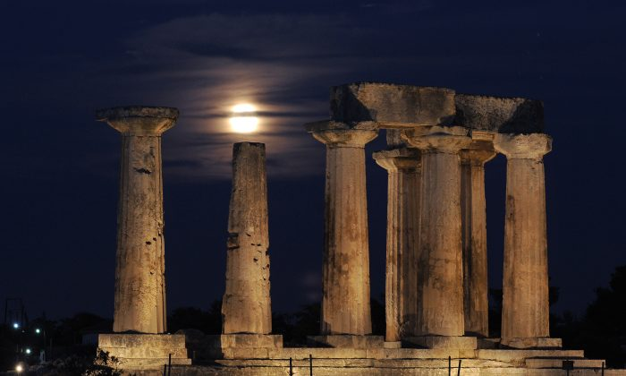 A full moon rises behind the Temple of Apollo in Ancient Corinth on Aug. 21, 2013. (Valerie Gache/AFP/Getty Images)