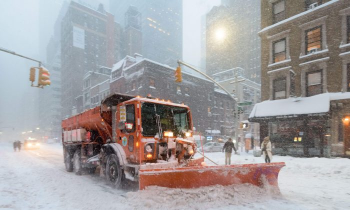 A snowplow clears snow on Lexington Avenue during the snowstorm January 2016 in New York. (Francois Xavier Marit/AFP/Getty Images)