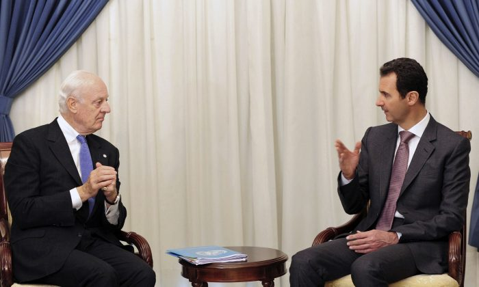 FILE - In this Nov. 10, 2014, file photo released by the Syrian official news agency SANA, Syrian President Bashar Assad (R) speaks with United Nations envoy to Syria Staffan de Mistura in Damascus, Syria. (SANA via AP, File)