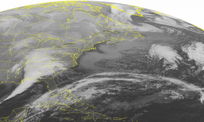 This NOAA satellite image taken Friday, Jan. 22, 2016, at 12:45 AM EST, shows an area of low pressure rapidly gaining strength over the southern Mississippi River Valley. This area of low pressure is bringing heavy rain to the Southeast as well as strong thunderstorms for the Gulf Coast States and eventually into Florida. Some isolated tornadoes are possible with these storms in addition to the heavy rain, hail, and lightning. This storm will slowly move towards the southern Mid-Atlantic and bring heavy snow and wind. Blizzard conditions are likely. Some locations will see over two feet of snow with this system. High pressure over New England will bring cold temperatures and dry conditions. Areas of lake effect snow will occur across the Great Lakes. (Weather Underground via AP)