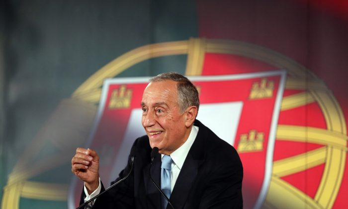 Marcelo Rebelo de Sousa smiles while addressing supporters during his presidential election campaign in Lisbon on Jan. 20, 2016. A poll published Friday, Jan. 22, 2016, in weekly Expresso suggested Rebelo de Sousa, a veteran center-right politician who became a popular television personality, will collect more than 50% of votes against nine rivals in the Jan. 24 Portuguese presidential election. In Portugal the president has no executive power, which is held by the government, but is an influential voice. (AP Photo/Armando Franca)