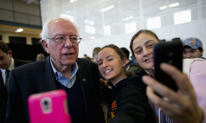 Democratic presidential candidate Sen. Bernie Sanders (I-Vt.) takes a selfie with young supporters at a campaign event in Iowa Falls, Iowa, on Jan. 25, 2016. (AP Photo/Jae C. Hong)