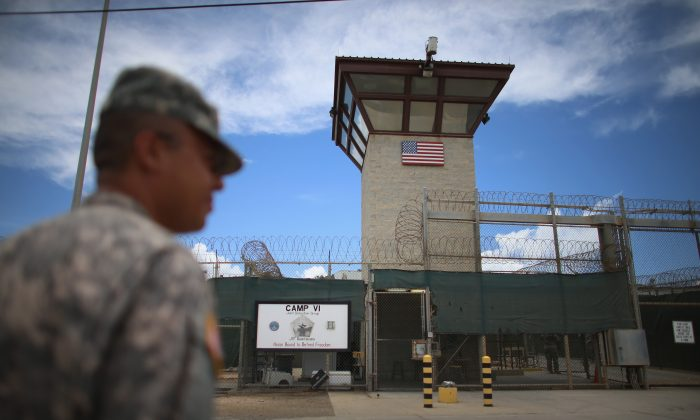 A military officer stands guard near the entrance to Camp VI at the Guantánamo Bay Naval Base in Cuba on March 30, 2013. (Joe Raedle/Getty Images)