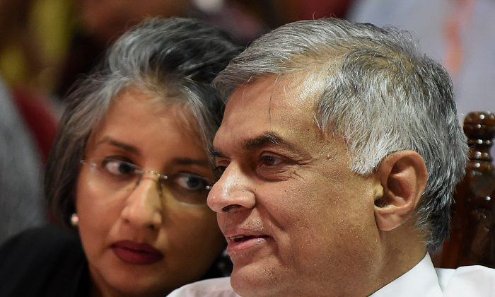 Sri Lanka Prime Minister Ranil Wickremesinghe (R) and his wife Maithree Wickramasinghe (L) pictured on January 16, 2016 (ISHARA S.KODIKARA/AFP/Getty Images).