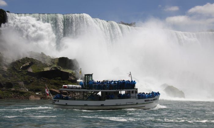 FILE--In this Friday, June 11, 2010 file photo, tourists ride the Maid of the Mist tour boat at the base of the American Falls in Niagara Falls, N.Y. New York officials are considering temporarily turning Niagara Falls into a trickle. State officials are holding a public hearing this week to discuss plans for replacing 115-year-old bridges linking the mainland to islands near the brink of Niagara Falls. To do so, they might reduce the flow on the American side of the falls by building a temporary structure to redirect Niagara River water to the Canadian side. (AP Photo/David Duprey, File)