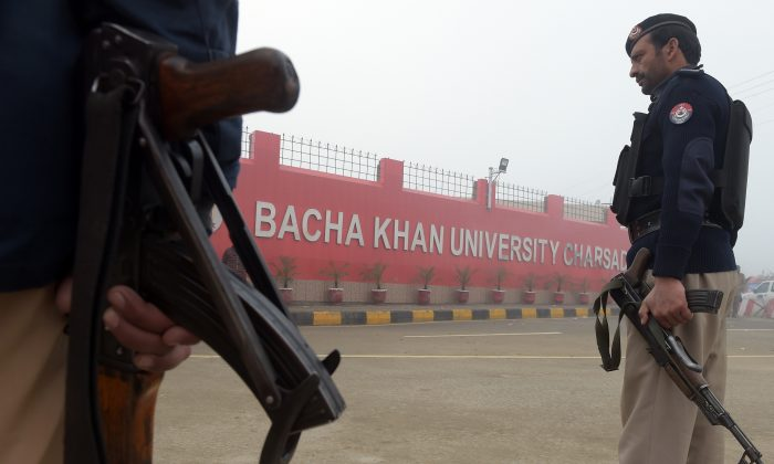A Pakistani policeman stands guard in front of a school in Peshawar on Jan. 21, 2016, a day after militant attack on Bacha Khan University. (Hasham Ahmed/AFP/Getty Images)
