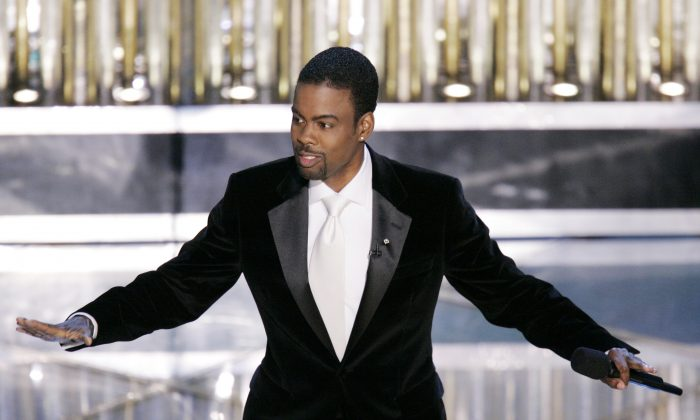 FILE - In this Feb. 27, 2005, file photo, Oscar Host Chris Rock performs his monologue to open the 77th Academy Awards telecast in Los Angeles. When Rock first hosted the Oscars in 2005, four black actors were nominated that evening. (AP Photo/Mark J. Terrill, File)