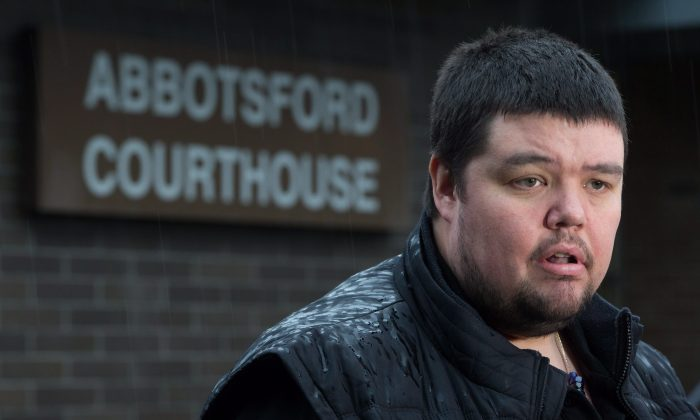 William Housty of the Heiltsuk First Nation speaks to reporters outside provincial court in Abbotsford, B.C., on Jan. 27, 2016. Anaheim Ducks' defenceman Clayton Stoner, who didn't appear in court, has pleaded guilty to hunting without a licence and was fined $10,000 after being charged under the Wildlife Act after a grizzly bear was killed on the central coast in 2013. (The Canadian Press/Darryl Dyck)