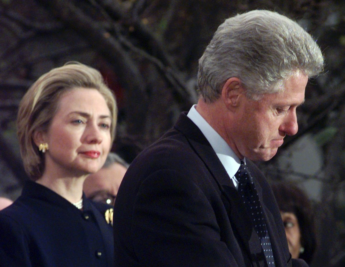 First lady Hillary Rodham Clinton watches President Clinton on Dec. 19, 1998, pause as he thanks those Democratic members of the House of Representatives who voted against impeachment. The long-running drama of Hillary Clinton's marriage—her husband's infidelity and how she dealt with it—is back as a subtext in this year's presidential race. (AP Photo/Susan Walsh)