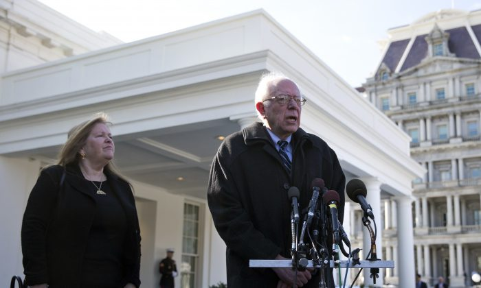 Democratic presidential candidate Sen. Bernie Sanders (I-Vt.), joined by his wife Jane Sanders (L), talks to media outside the West Wing of the White House in Washington, D.C., on Jan. 27, 2016, after meeting with President Barack Obama. (AP Photo/Carolyn Kaster)