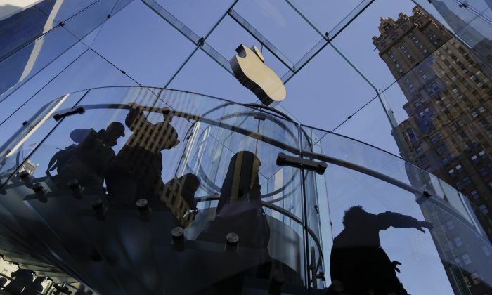 A group of visitors to the Apple store descends a staircase to the showroom below in New York on Sept. 19, 2014. (AP Photo/Julie Jacobson)