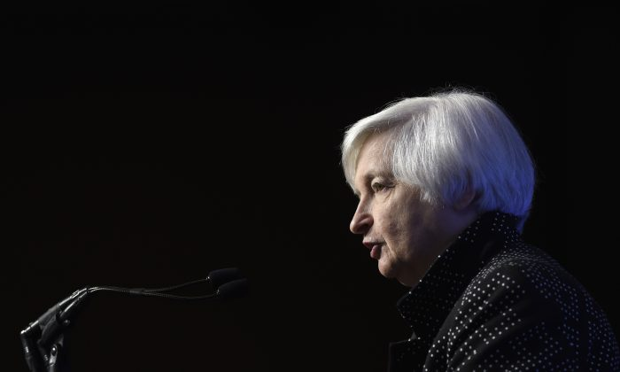 Federal Reserve Chair Janet Yellen speaks at the Economics Club of Washington in Washington, D.C., on Dec. 2, 2015. The Federal Reserve is widely expected to keep interest rates unchanged when it ends a policy meeting on Jan. 27, 2016. At its last meeting in December, it raised interest rates from record lows. Since then, the global picture has darkened and stock markets have plunged. (AP Photo/Susan Walsh)