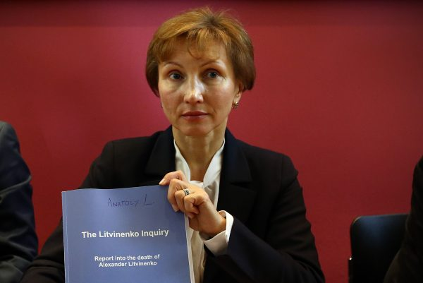 Marina Litvinenko holds a copy of a report at a news conference in her lawyer's office after receiving the results of the investigation into the death of her husband Alexander Litvinenko on January 21, 2016 in London, England.  Alexander Litvinenko, a former KGB official who was poisoned with radioactive polonium-210 in Britain in 2006, fled to Russia after criticizing President Vladimir Putin.  (Karl Court/Getty Images)