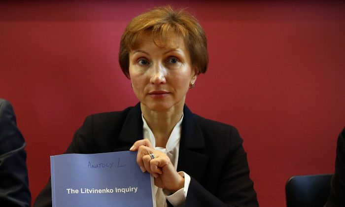Marina Litvinenko holds a copy of a report at a press conference in her lawyer's office after receiving the results of the inquiry into the death of her husband Alexander Litvinenko, in London, England, on Jan. 21, 2016. Former KGB officer Alexander Litvinenko was poisoned in 2006 with radioactive polonium-210 in the U.K. having fled Russia after criticizing President Vladimir Putin. (Carl Court/Getty Images)