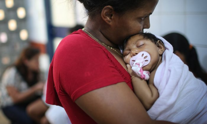 Grandmother Ivalda Caetano holds Ludmilla Hadassa Dias de Vasconcelos (2 months), who has microcephaly, at Oswald Cruz Hospital in Recife, Brazil, on Jan. 26, 2016. (Mario Tama/Getty Images)