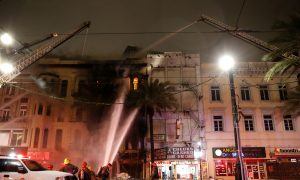 New Orleans Firefighters at Building Fire on Canal Street