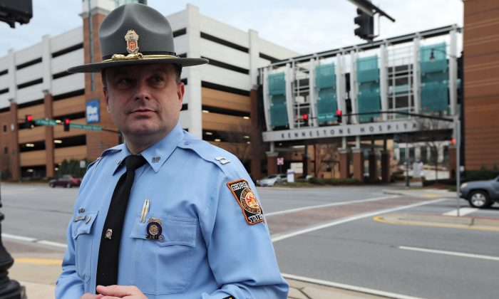 Georgia State Police Cpt. Mark Perry briefs the media outside of WellStar Kennestone Hospital following an officer-involved shooting in which the suspect and an officer were both shot on I-75 in Cobb County on Jan. 27, 2016. (Ben Gray/Atlanta Journal-Constitution via AP)