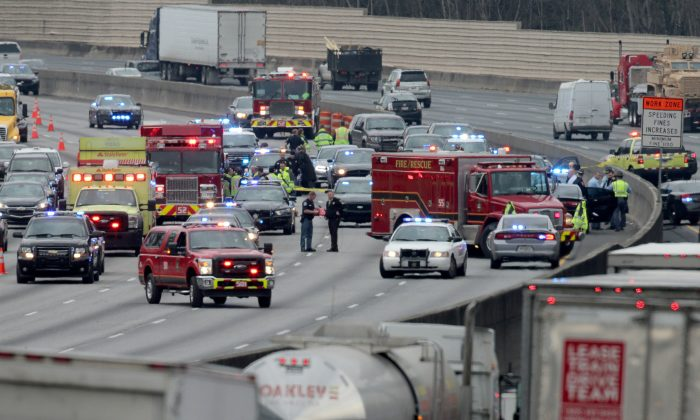 Police work at the scene of an officer-involved shooting on I-75 in Cobb County on Wednesday, Jan. 27, 2016. (Ben Gray/Atlanta Journal-Constitution via AP)