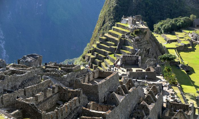 Tourists walk among the ruins of the Machu Picchu citadel, 130 km northwest of Cusco, Peru on July 6, 2011. (Cris Bouroncle/AFP/Getty Images)