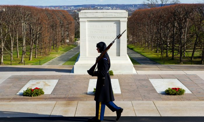 A U.S. Army soldier, from the 3rd Infantry Regiment, walks his tour at the Tomb of the Unknowns at Arlington National Cemetery in Arlington, Va., on Dec. 22, 2012. (Karen Bleier/AFP/Getty Images)