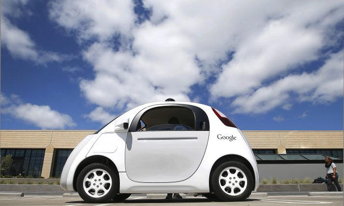 FILE - This May 13, 2015 file photo shows Google's new self-driving car during a demonstration at the Google campus in Mountain View, Calif. (AP Photo/Tony Avelar, File)
