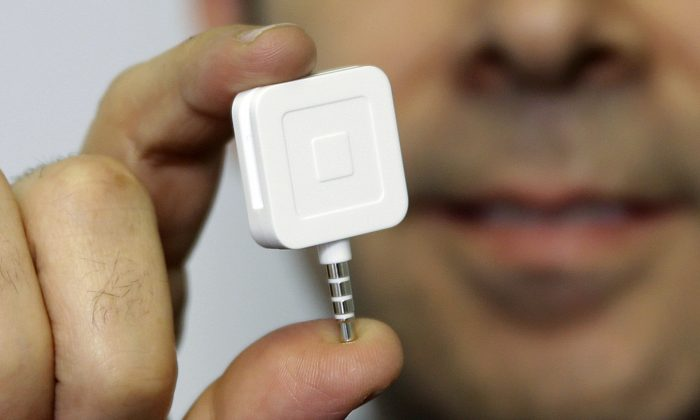 A Square reader in a file photo. (AP Photo/Seth Wenig, File)