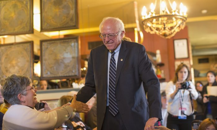 Democratic presidential candidate, Sen. Bernie Sanders, I-Vt. arrives for a campaign a campaign event at Cafe Dodici, Friday, Jan. 29, 2016, in Washington, Iowa. (AP Photo/Evan Vucci)
