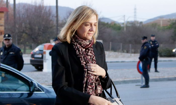 FILE - In this Monday, Jan. 11, 2016, file photo, Spain's Princess Cristina arrives at a makeshift courtroom for a corruption trial, in Palma de Mallorca, Spain. A court official says Spain's Princess Cristina has lost her bid to avoid being tried for tax fraud in a corruption trial that also ensnared her husband and 16 others. The official says a panel of judges rejected Cristina's argument that she should not be tried because a prosecutor recommended she face at most administrative fines. (AP Photo/Emilio Morenatti, File)