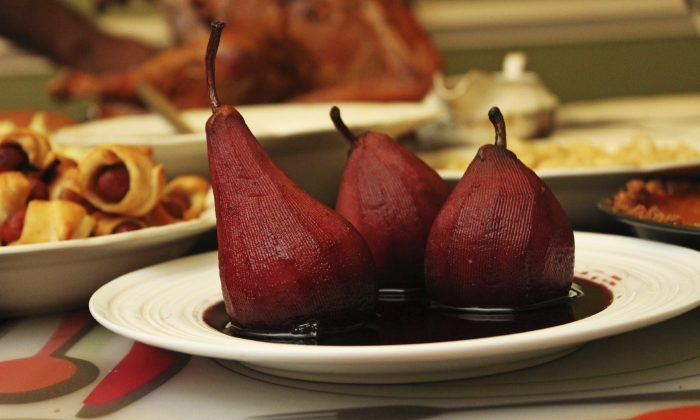 Pears cooked in red wine with a ginger and sherry sauce. (vm2002/iStock)