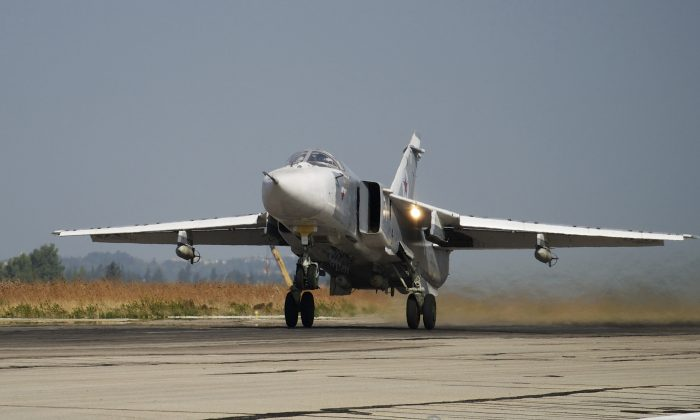 A Russian Su-24 takes off on a combat mission at Hemeimeem airbase in Syria on Oct. 22, 2015. (AP Photo/Vladimir Isachenkov)