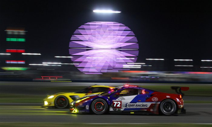The #72 SMP Racing Ferrari Battle on of the Corvettes entering the International Horseshoe just before the halfway point of the 2016 Rolex 24 at Daytona. (Chris Jasurek/Epoch Times)