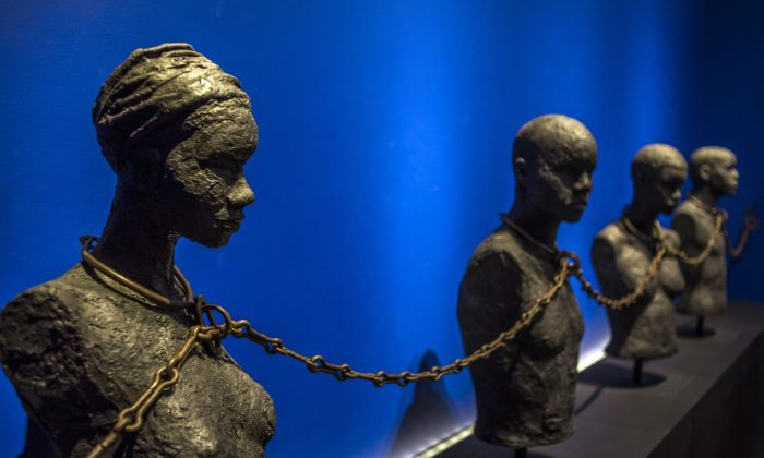 "A photo taken on May 8, 2015 shows a piece entitled ""Slave Chain with Four Yokes"" from the Dexue voodoo convent in Adounko, Benin, dating from the 19th century at the Memorial ACTe, the Caribbean Centre of Expression and Memory of Slavery and the Slave Trade, in Point-a-Pitre. The memorial will be inaugurated by French President Francois Hollande on May 10, the National Day for the Abolition of Slavery and the Slave Trade in France. AFP PHOTO / NICOLAS DERNE        (Photo credit should read NICOLAS DERNE/AFP/Getty Images)"