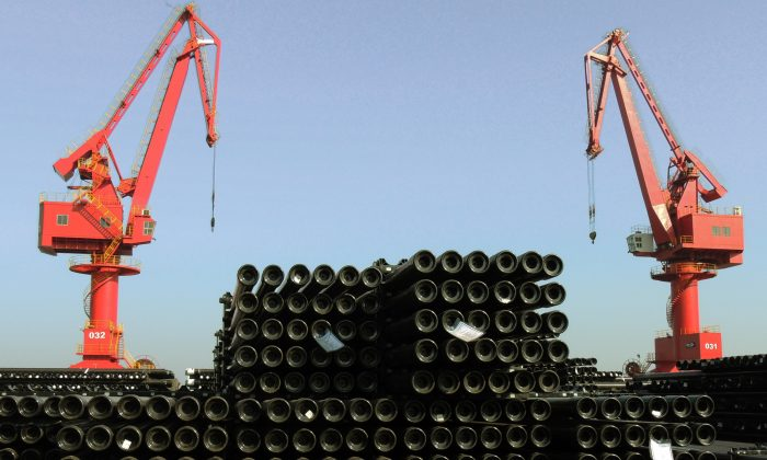 Steel pipes at a port in Lianyungang, eastern China's Jiangsu province, are being loaded for export on Dec. 1, 2015. (STR/AFP/Getty Images)