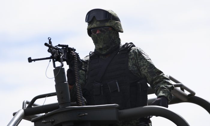 """A soldier patrols on the perimeters of the Altiplano maximum security prison in Almoloya, west of Mexico City, on Jan. 9, 2016, where Joaquin """"El Chapo"""" Guzman, head of the Sinaloa Cartel, is being held after his recaptur. (AP Photo/Marco Ugarte)"""