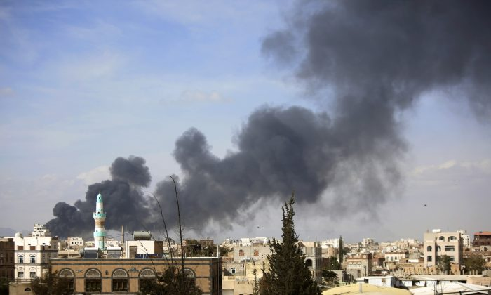 Smoke rises after Saudi-led airstrikes hit a site in Sanaa, Yemen, on Jan. 30, 2016. Airstrikes by the Saudi-led coalition targeting Yemen's Shiite rebels killed over 32 people overnight including at least eight civilians in the capital Sanaa, officials said on Saturday. (AP Photo/Hani Mohammed)