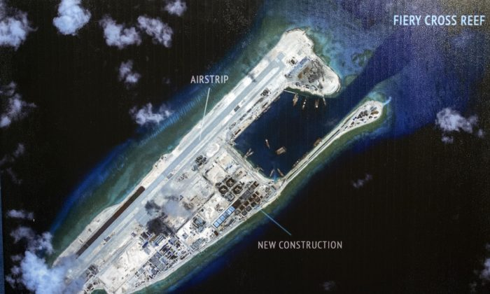 "An island that China is building on the Fiery Cross Reef in the South China Sea. The Chinese regime is accusing the United States of ""hegemony"" for challenging its land-grab in the South China Sea. (Cliff Owen/AP)"