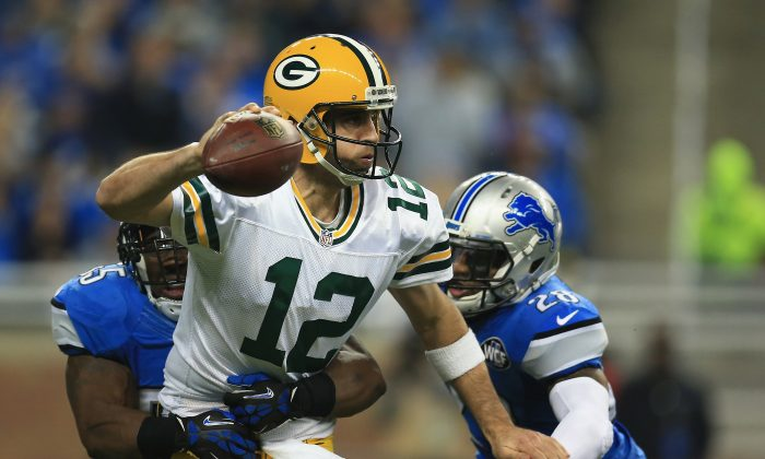 Aaron Rodgers (C) of the Green Bay Packers played a memorable game against the Detroit Lions on Dec. 3, 2015 when his 61-yard throw found teammate Richard Rodgers in the end zone for the last-second win. (Andrew Weber/Getty Images)