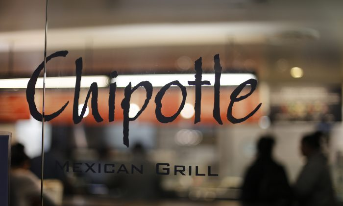 A Chipotle restaurant in Union Station in Washington, D.C., on Dec. 27, 2015. The Centers for Disease Control and Prevention (CDC) said Monday, Feb. 1, 2016, that the E. coli outbreak at Chipotle restaurants appears to be over, and that they are closing the investigation. (AP Photo/Gene J. Puskar)