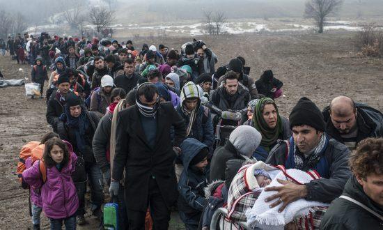 Merkel Vows to Keep Seeking Common Ground on Migrants