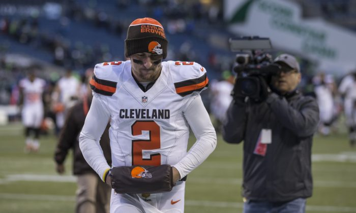 Quarterback Johnny Manziel of the Cleveland Browns has made more news off the field than on it in his two years in the league. (Stephen Brashear/Getty Images)