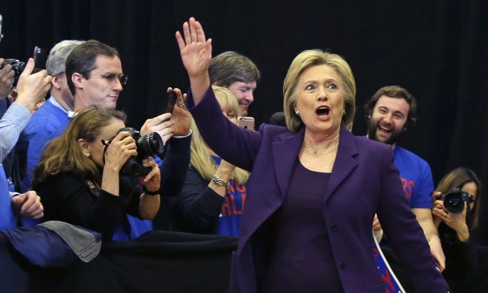 Democratic presidential candidate Hillary Clinton waves as she arrives at a campaign event on Feb. 2 in Nashua, N.H. (AP Photo/Elise Amendola)