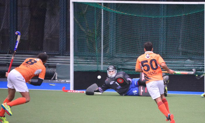 SSSC's Satwinder Singh launches a strike only to have Khalsa goalkeeper Aiden Ibrahim diving to deny him in their HKHA Premier-A match at King's Park on Sunday Jan 31, 2019. (Eddie So)